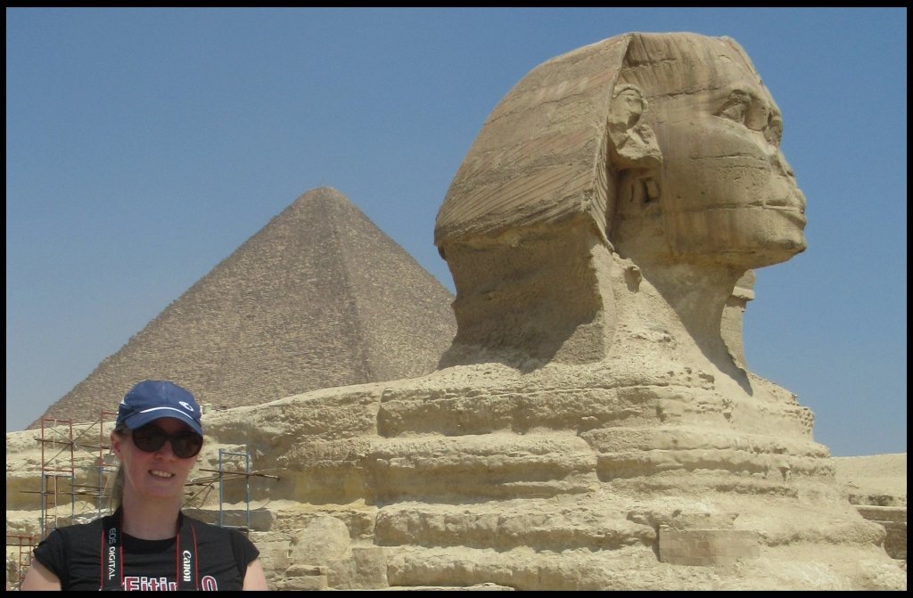 Christine Johnston with the Sphinx and Pyramids at Giza