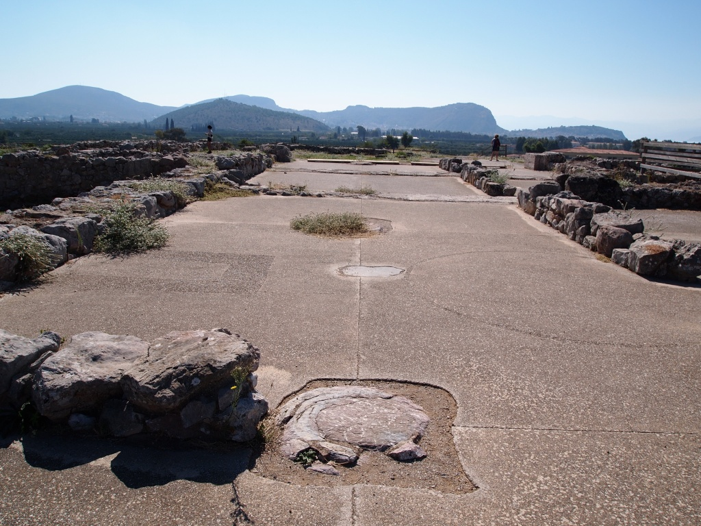Palatial megaron at Tiryns with multiple phases visible. The position of the hearth and the throne are outlined in the foreground, and the picture was taken from the north. Photo by Rebecca Worsham.
