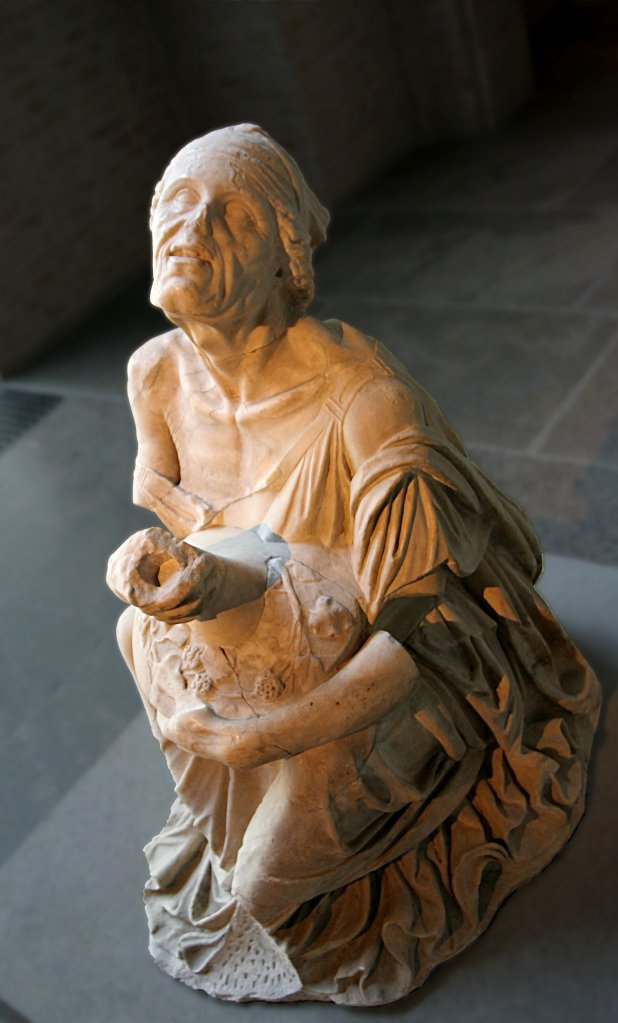 Old Drunken Woman: This old woman cradles a large wine jar in her lap as she sits happily drunk on a rock. The fine quality of her garments and jewelry and of the sculpture itself suggests that she is not poor and downtrodden. She may have been a wealthy participant in a festival of Dionysos who commissioned this sculpture as an offering to the god of wine. Statue, Glyptothek, Munich, Roman copy of a Greek original of the 3rd century B.C.