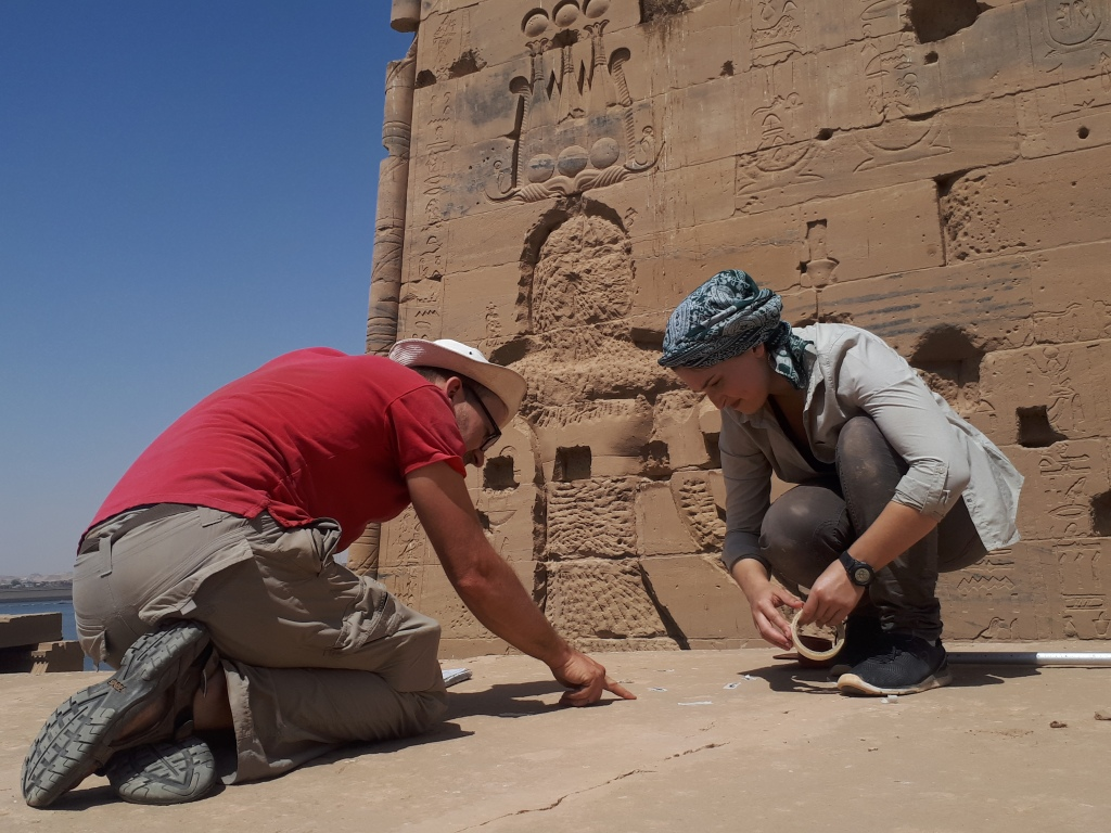 Dr. Jitse Dijkstra and a graduate student working at the Temple of Isis at Philae