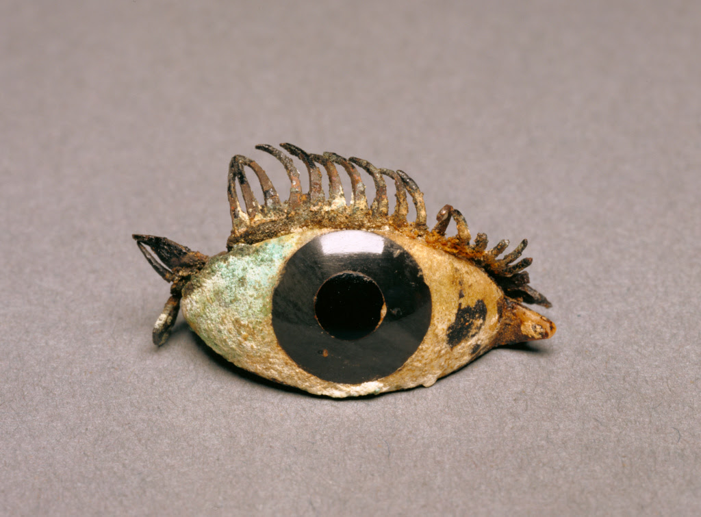 Eye from a Bronze Statue, 5th - 2nd century B.C., Marble, obsidian, glass, and copper; 2.1 × 4.9 cm (13/16 × 1 15/16 in.), 84.AI.625. The J. Paul Getty Museum, Villa Collection, Malibu, California