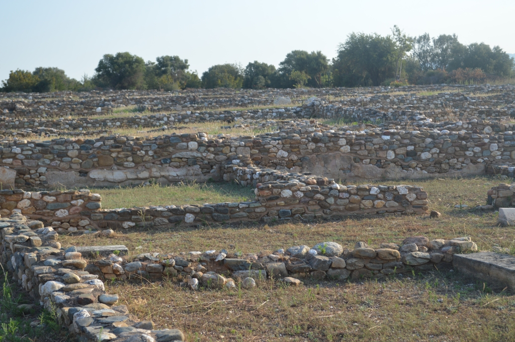 Stone foundations (partially reconstructed) from the archaeological site of Olynthos.