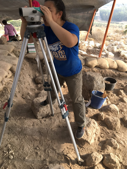 UBC student Christine Lee using a total station.
