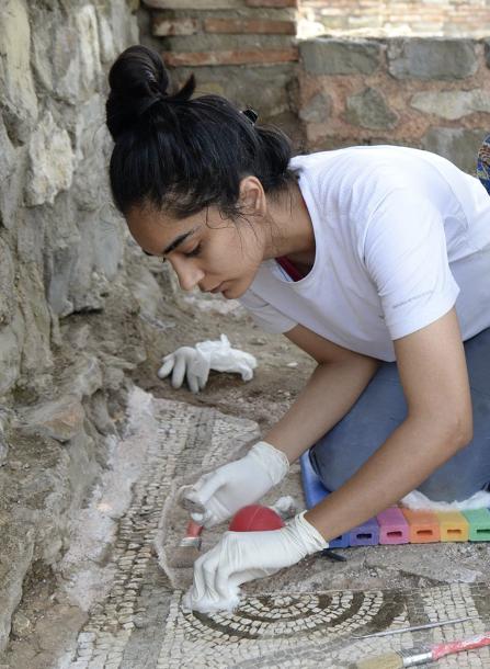 The author performing mosaic conservation at Stobi, Macedonia (photo by Mishko Tutkovski)