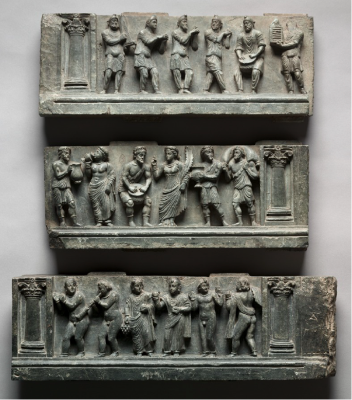 Reliefs from a Gandharan Buddhist stupa in Buner region at Cleveland Museum of Art showing various groups of people, Scythians, Greeks, and local monks, drinking, dancing, and playing music. CC0 1.0 License.