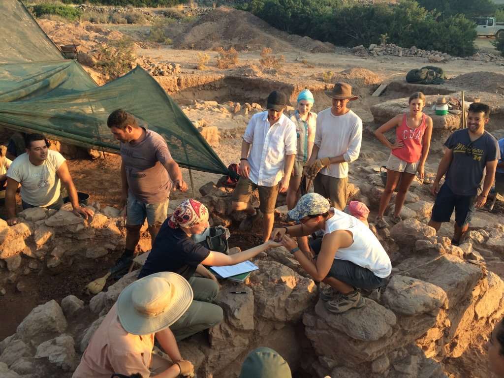 Uncovering a miniature pot during excavations at Palaikastro, Crete in June 2015. Photograph by the author.