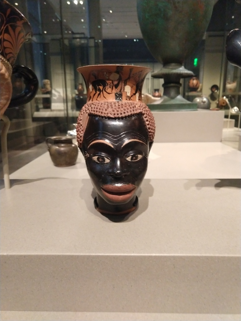 Athenian plastic mug in the form of a black man's head and face, ca. 510 BCE. Museum of Fine arts, Boston (www.mfa.org). Photo by Author.