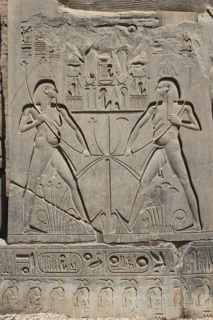 Unification iconography featuring the inundation god Hapy, statue base of Ramesses II, Luxor (photo by C. Johnston).
