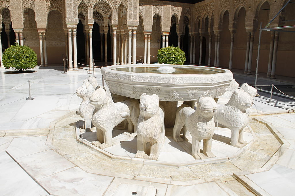 Small fountain held up by lions at Alhambra Palace, Spain.