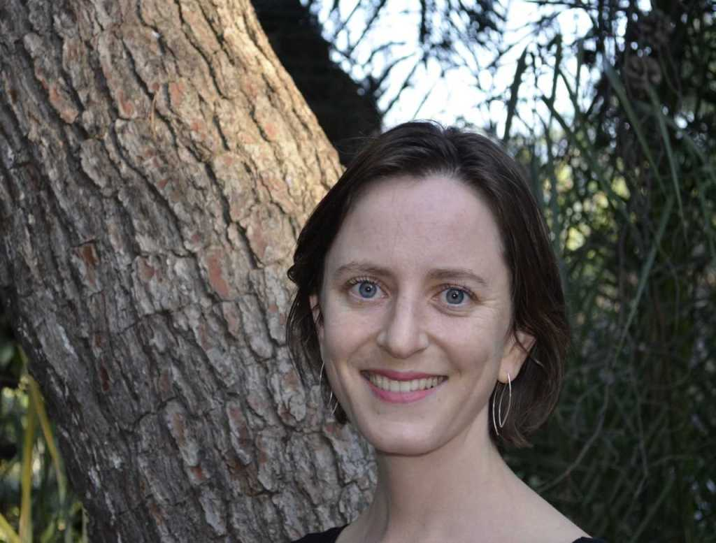 Image of Grace Erny in front of a tree