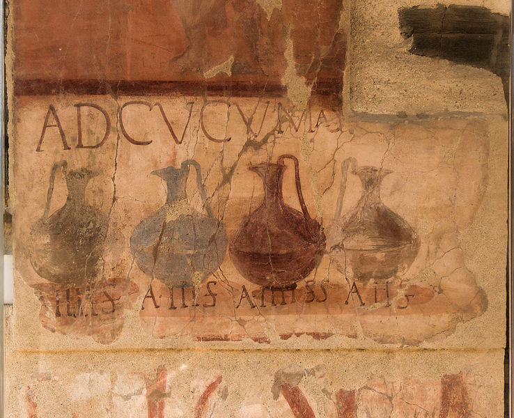 """A painted advertisement on an ancient wall from Herculaneum. I depicts four wine-pouring vessels with a Latin inscriptions that reads, """"Ad Cucumas"""". Translation: """"to the cups (or cooking vessels)."""""""
