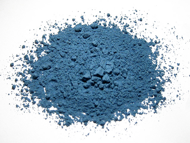 close-up of a ground, blue pigment which looks like a powder.