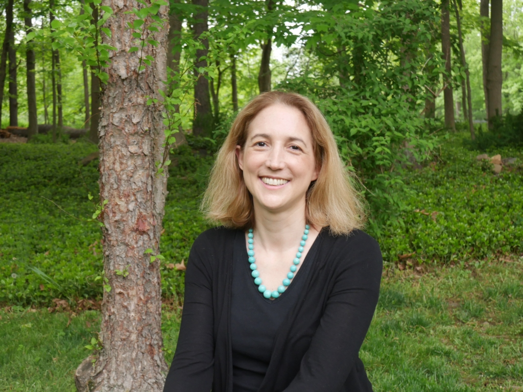 Photo of Dr. Blair Fowlkes Childs in front of trees and greenery.