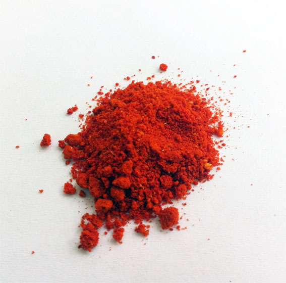 close-up of a ground, red pigment which looks like a powder.