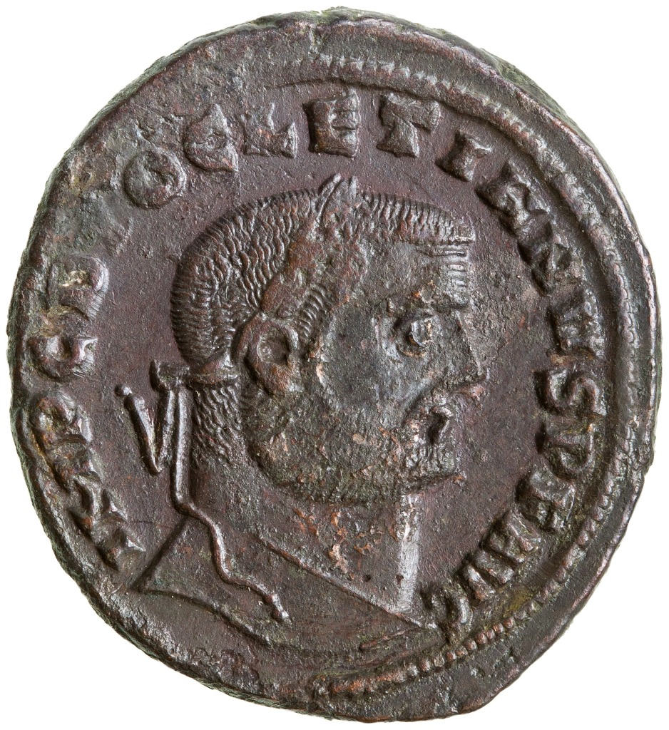 Bronze coin with the head of Diocletian in profile. There is a Latin inscription around the outside of the coin, which reads: IMP C DIOCLETIANVS P F AVG.