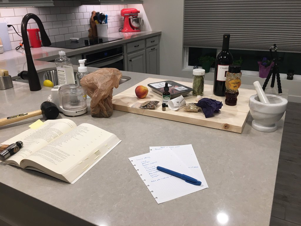 A collection of objects on a table used in the making of incense. This image was taken in a modern laboratory.