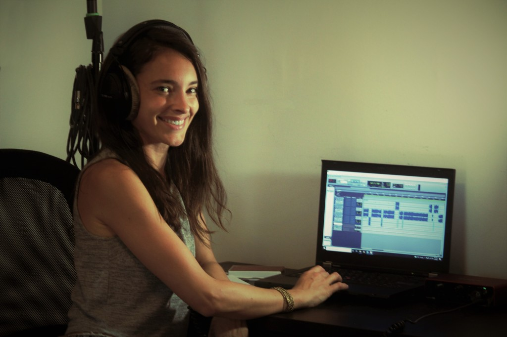 Image of Cassandra Palmer editing the Peopling the Past Podcast on her laptop.