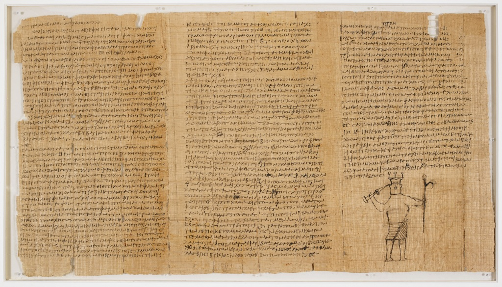 A Greek papyrus containing two spells. At the end of the papyrus is a drawing of the Egyptian god Bes.