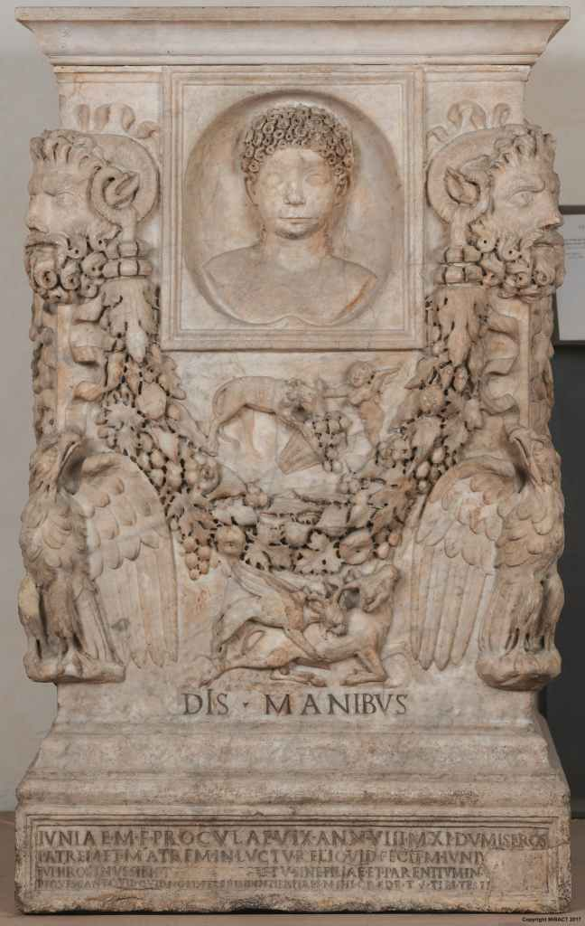 Marble altar in honour of Julila Procula showing an image of a young girl with foliage underneath the depiction.