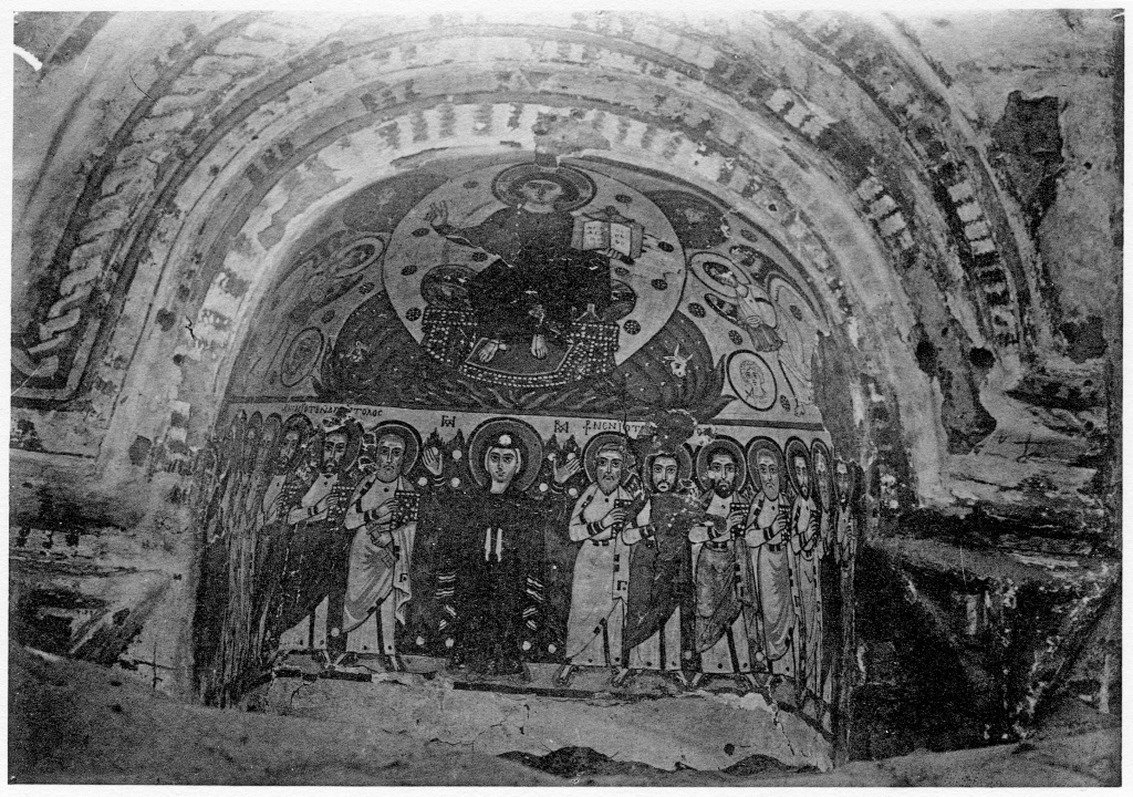 Photo of a painting of Mary in a wall niche from a monastery in Egypt. She is standing in the bottom centre of the composition flanked by several men on either side. Christ is in the upper register in a mandorla.