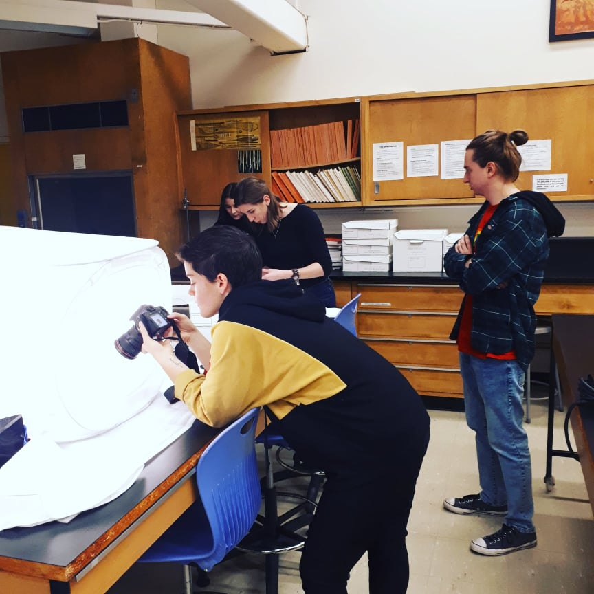 Students photographing their objects using a lightbox.